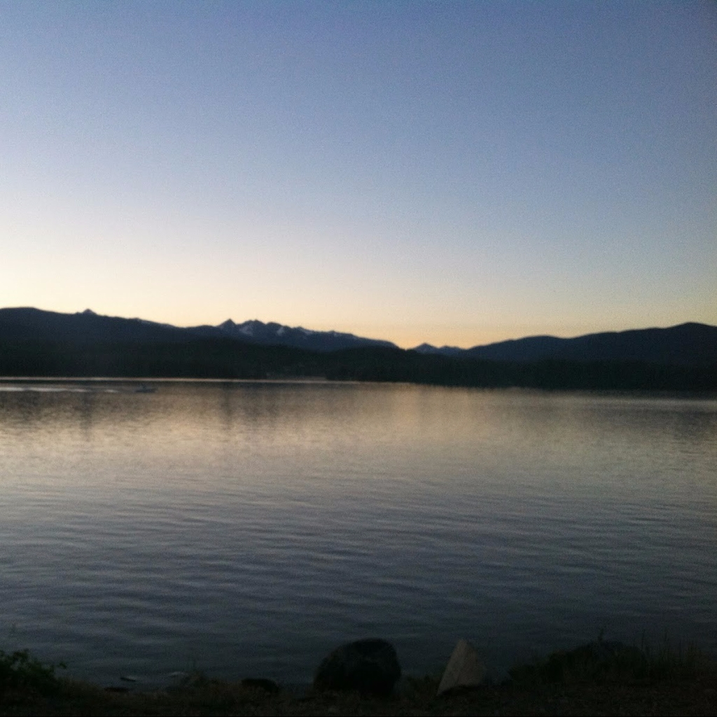 sunset at Shadow Mountain Reservoir with the mountains of Rocky Mountain National Park on the horizon