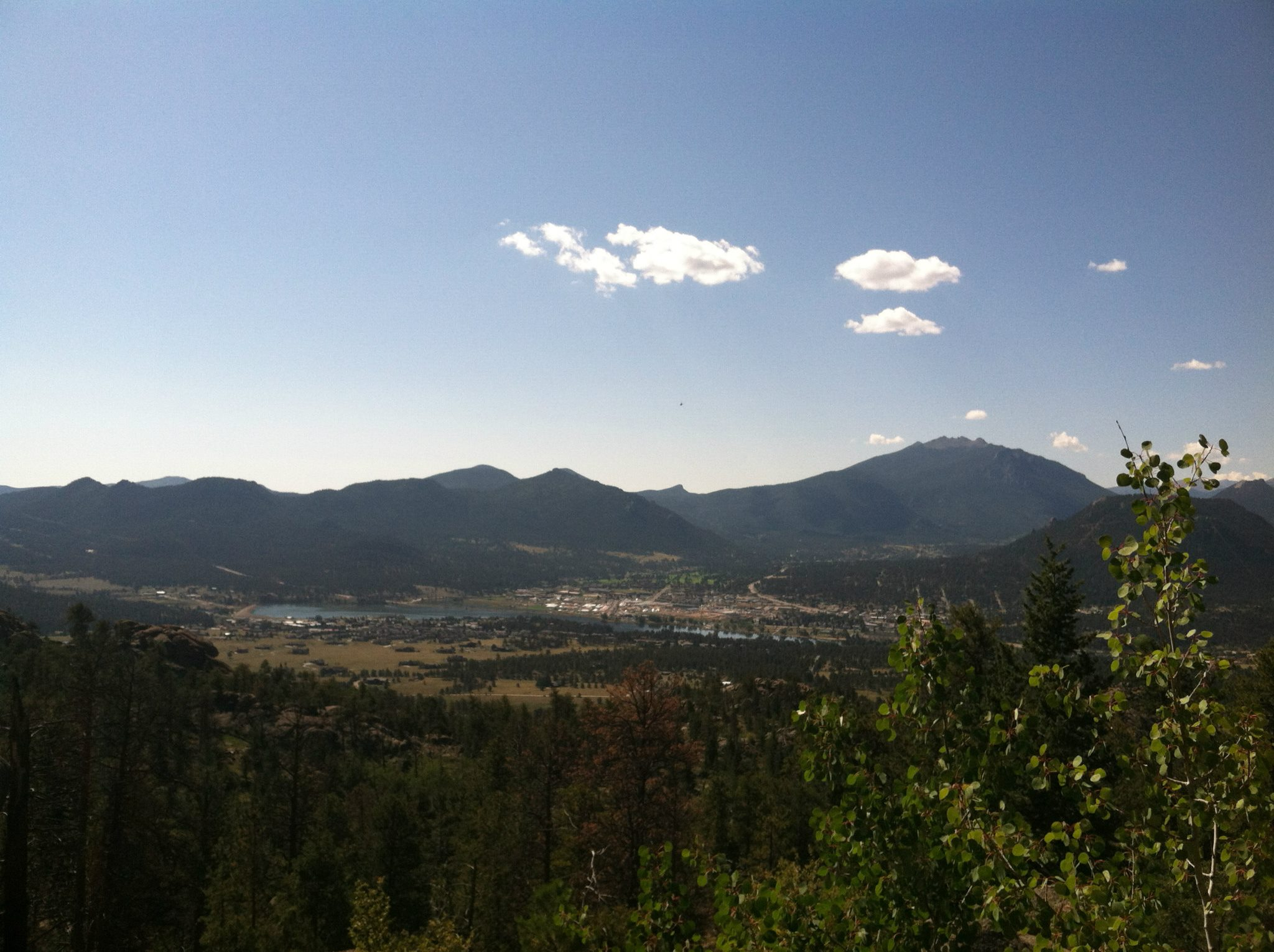 view from gem lake trail of the town of estes park, lake estes, and the Rocky Mountains