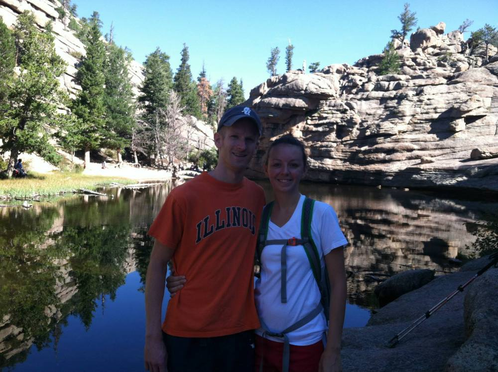 couple standing in front of gem lake in estes park colorado