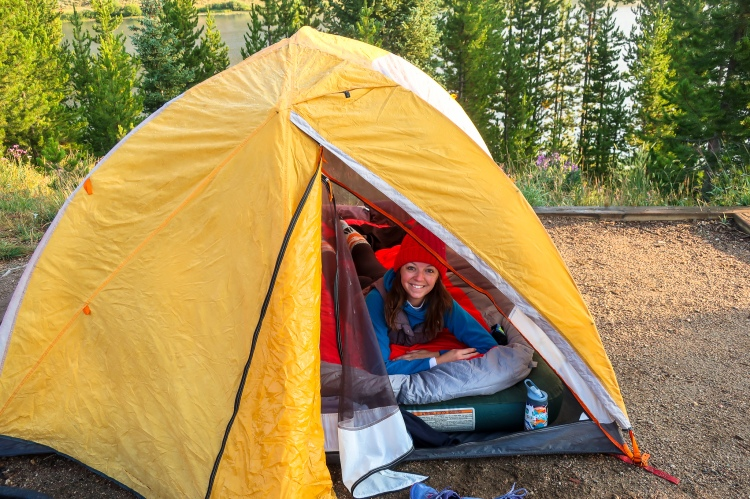 woman tent camping with double sleeping bag