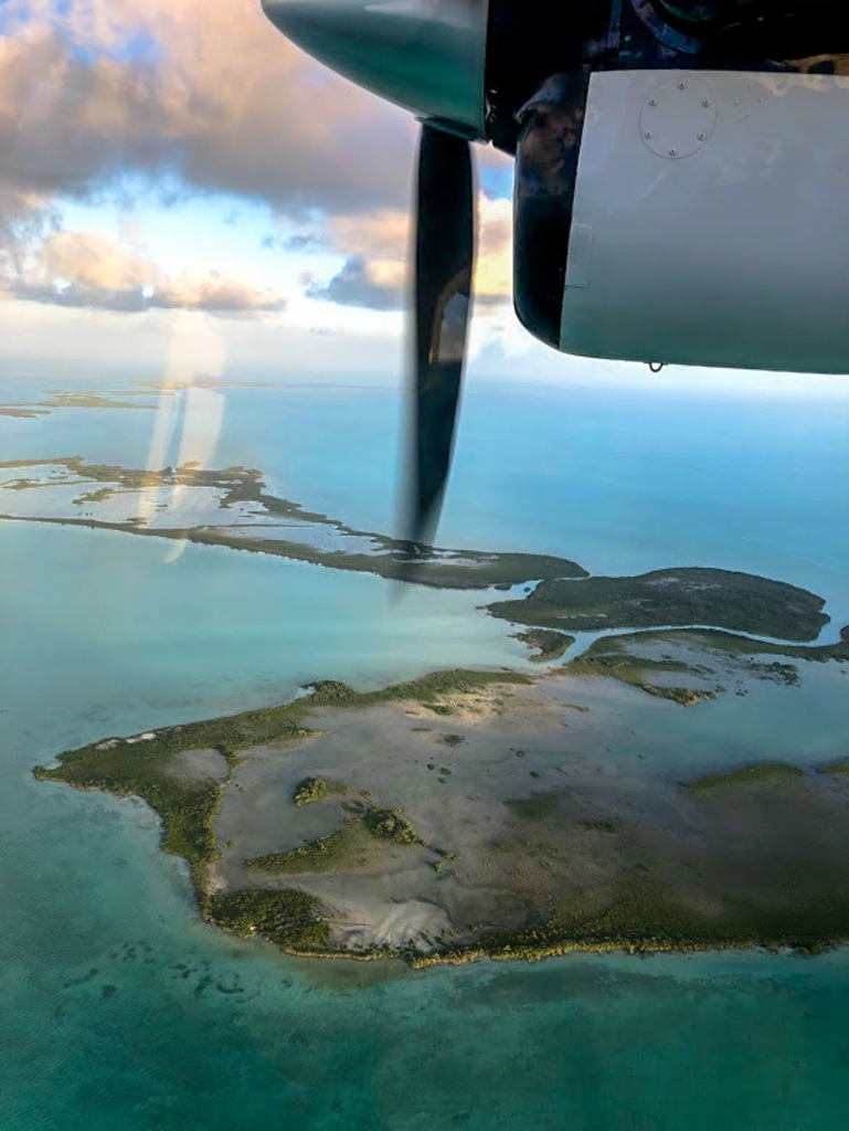 view from airplane flying over the caribbean sea to san pedro belize
