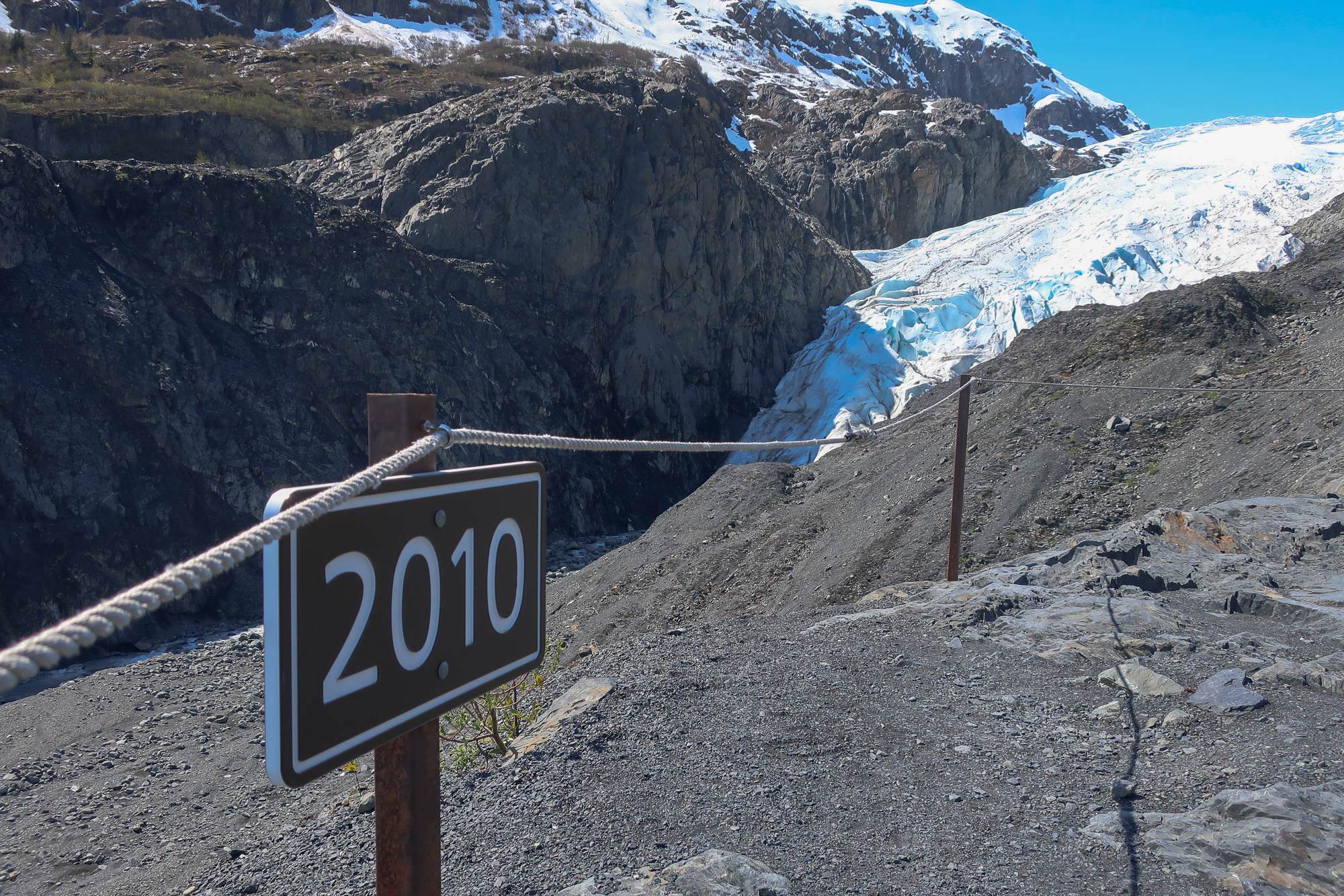 exit glacier interpretative sign marks where the glacier was in 2010, about a half-mile from where the glacier starts today
